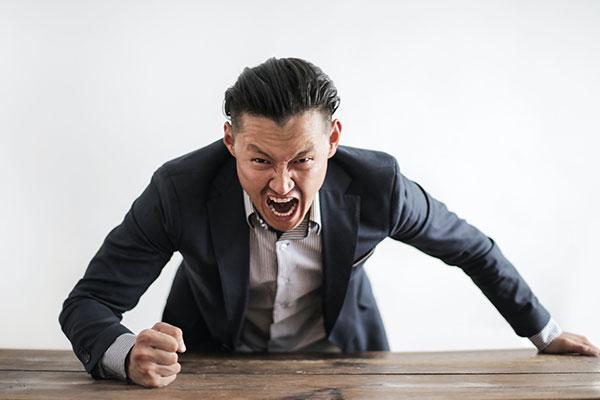 Angry man at meeting