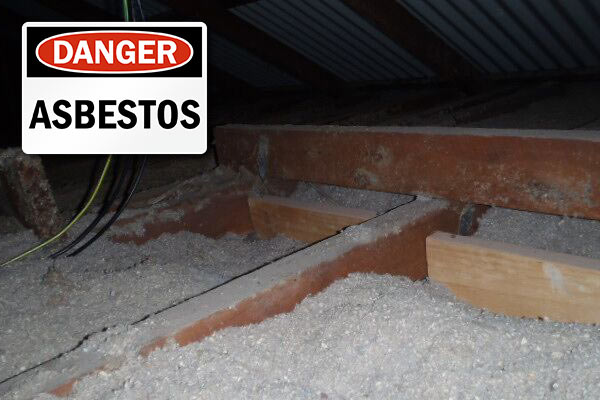 Asbestos loose fill in ceiling with danger sign