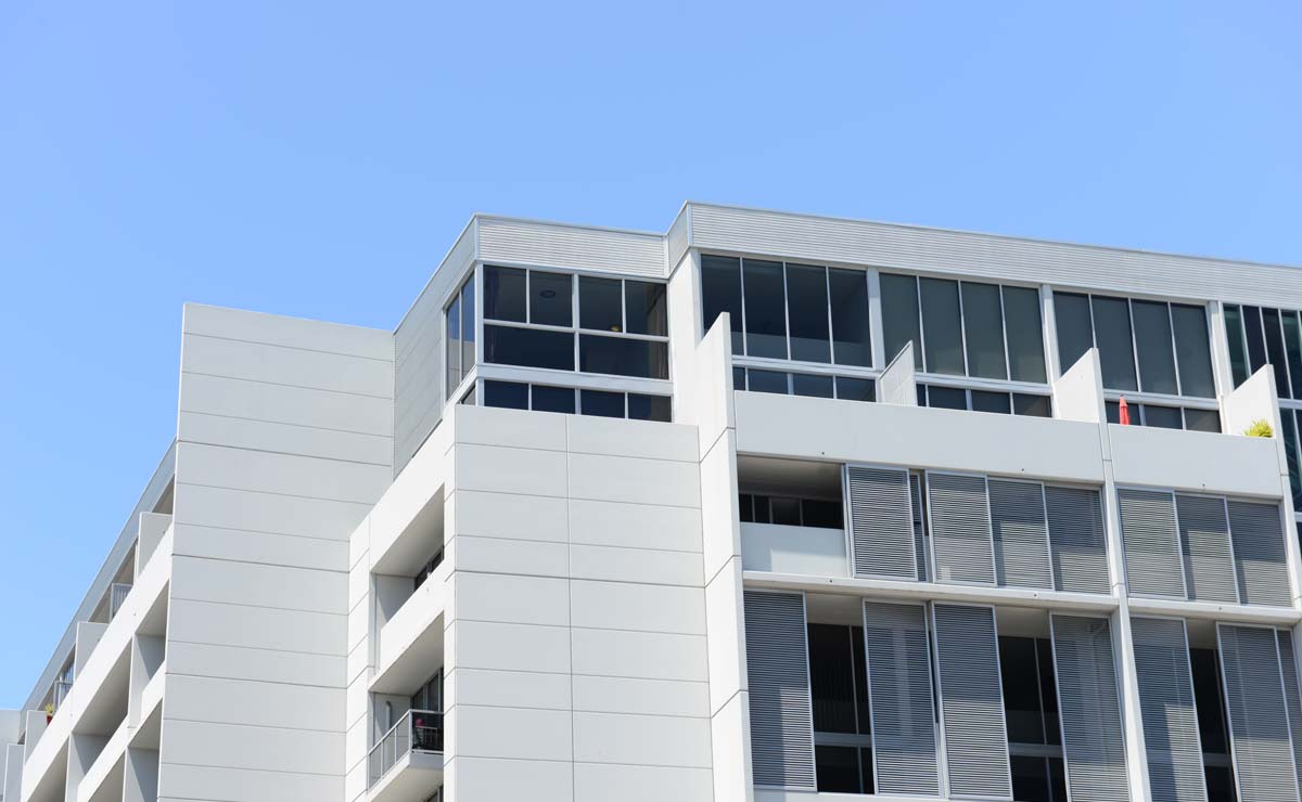 Modern white strata building with blue sky