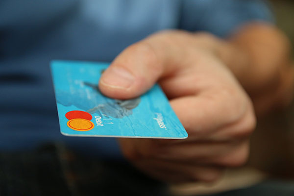 Person paying with credit card