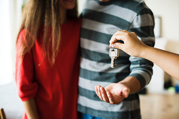 Keys being handed to couple