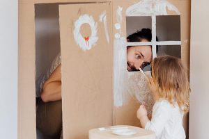 Home renovating with child helping