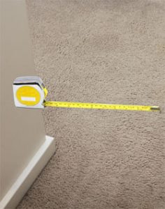 Measuring tape in apartment