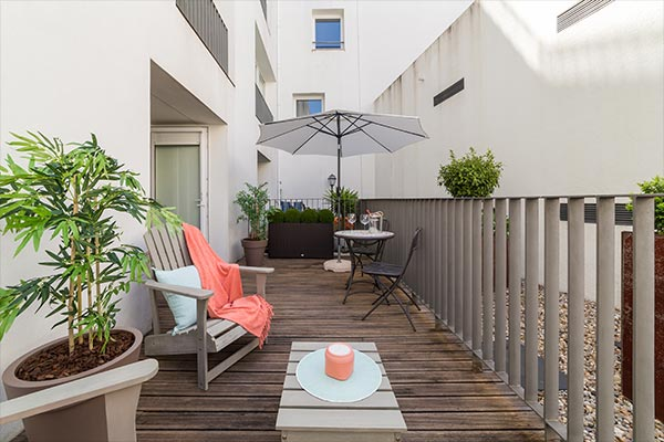 Apartment balcony with greenery and style