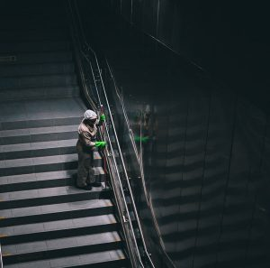Woman cleaning stairs